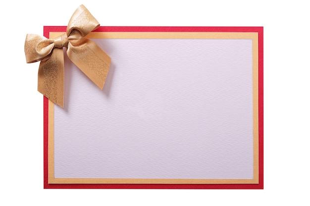 Cartão de natal com laço dourado e branco cópia espaço Foto Premium