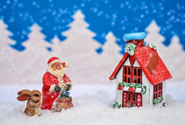 Cartão de natal onde o papai noel e o coelhinho