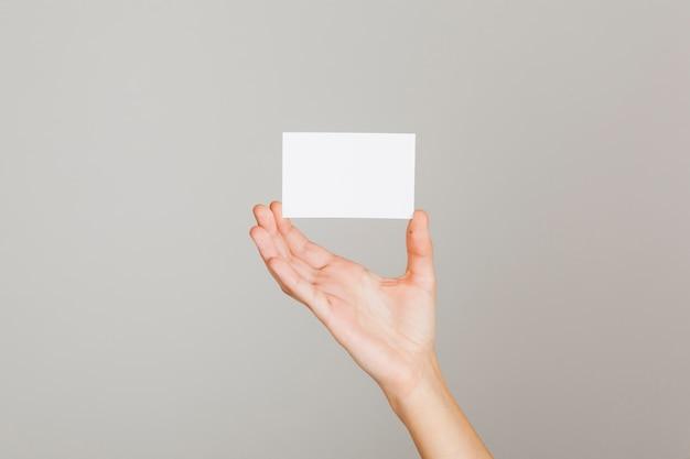 Cartão de visita e mão