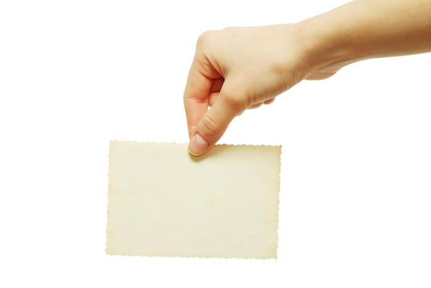 Cartão em branco em uma mão no branco Foto Premium