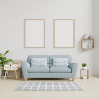 Cartaz interior com moldura de madeira vazia vertical em pé no chão de madeira com sofá e armário.