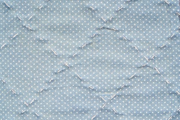 Carteira de tecido azul superfície closeup fundo texturizado