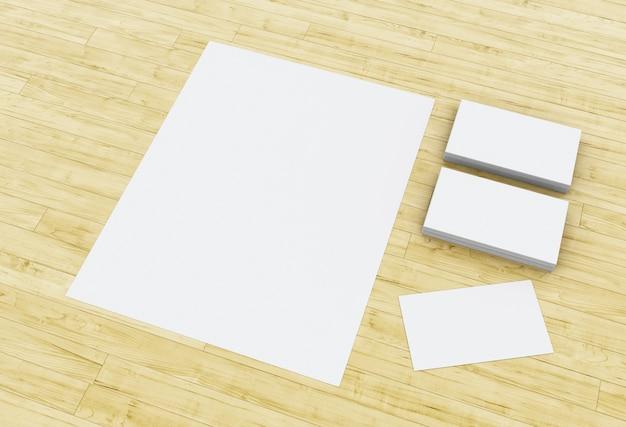 Cartões 3d e blocos de notas em branco na mesa de madeira.