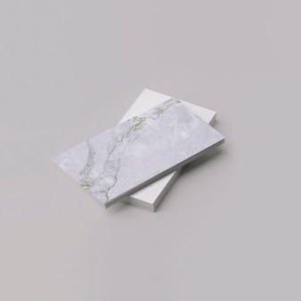 Cartões de visita empilham maquete de cartão de visita superior com textura de mármore e veios dourados