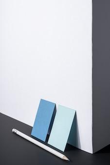 Cartões de visitas azuis do negócio dos artigos de papelaria