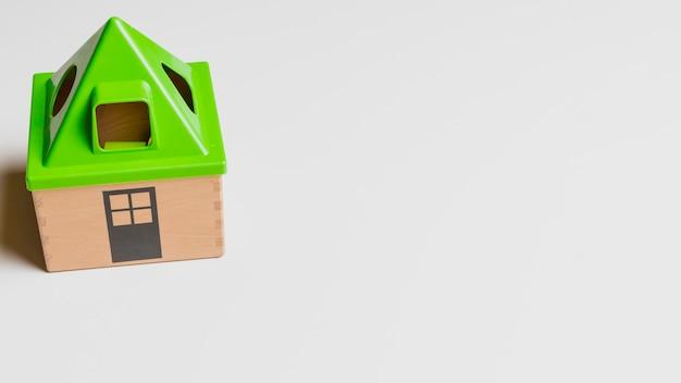 Casa de brinquedo e copyspace