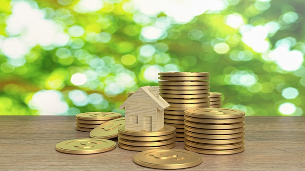 Casa de madeira e moedas de ouro na mesa de madeira para conteúdo de construção