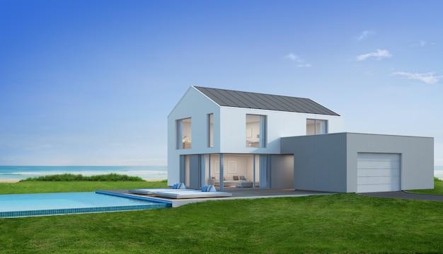 Casa de praia de luxo com piscina com vista para o mar em design moderno.