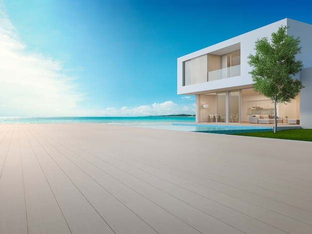Casa de praia de luxo com piscina vista mar e terraço em design moderno.