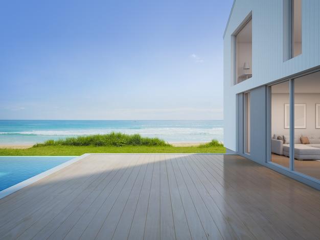 Casa de praia de luxo com piscina vista mar e terraço vazio em design moderno.