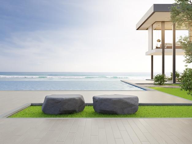 Casa de praia de luxo com vista para o mar piscina e terraço em design moderno.