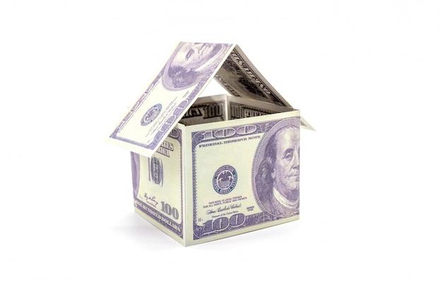 Casa feita de dinheiro dólar dinheiro isolado no branco