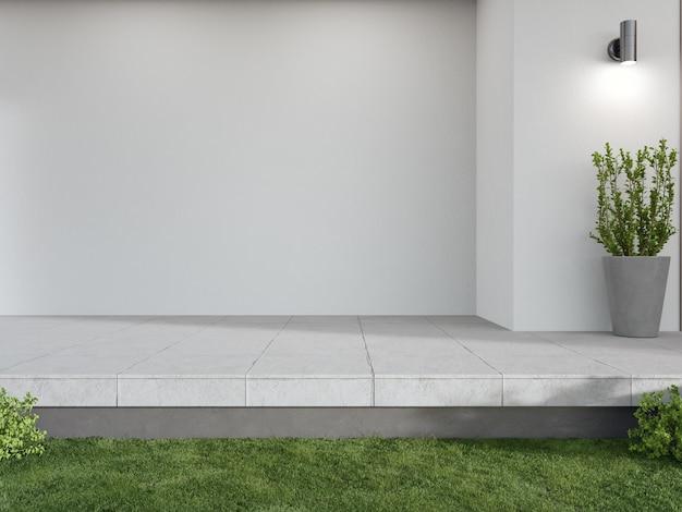 Casa nova com terraço com piso de concreto e parede branca vazia
