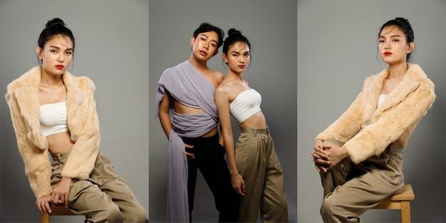 Casal fashion portrait of 20s asian lgbtqia + woman and man abraçam juntos. garota transgênero e gay fazem poses de fotos de beleza sobre fundo cinza isolado com sentimento de emoção