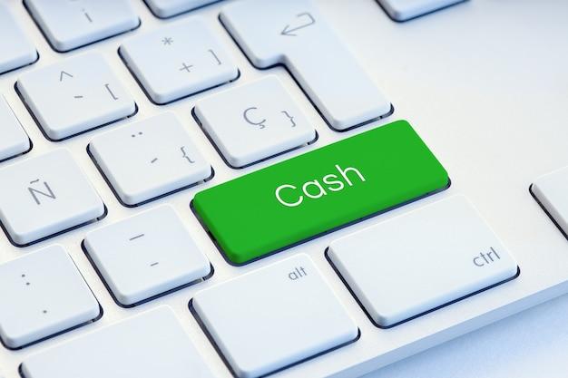 Cash word na tecla verde do teclado do computador