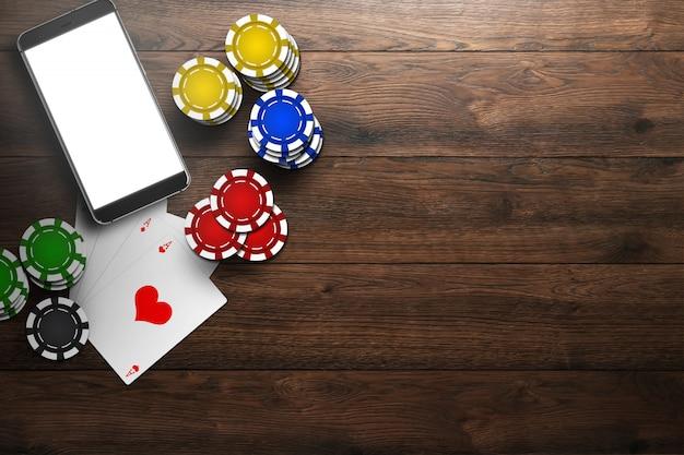 Casino online, cassino móvel, vista superior de um telefone celular, cartões com fichas na madeira