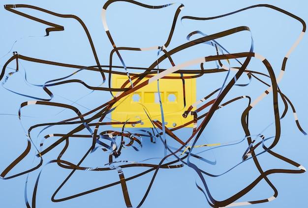 Cassete amarela velha com a fita enrolada na frente com a superfície azul. renderização 3d