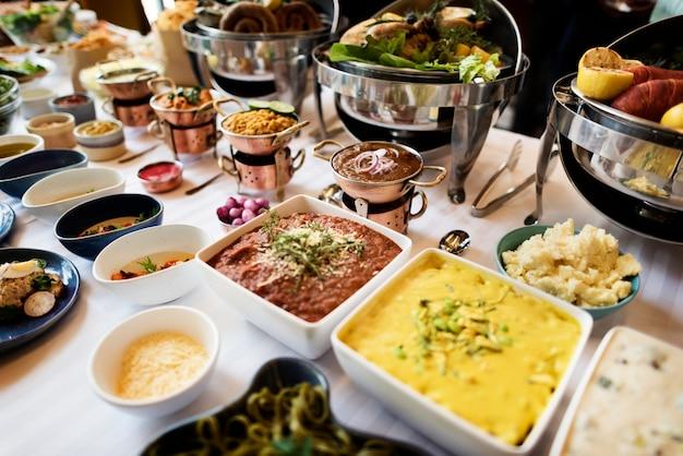 Catering do bufete do alimento que janta comer o partido que compartilha do conceito