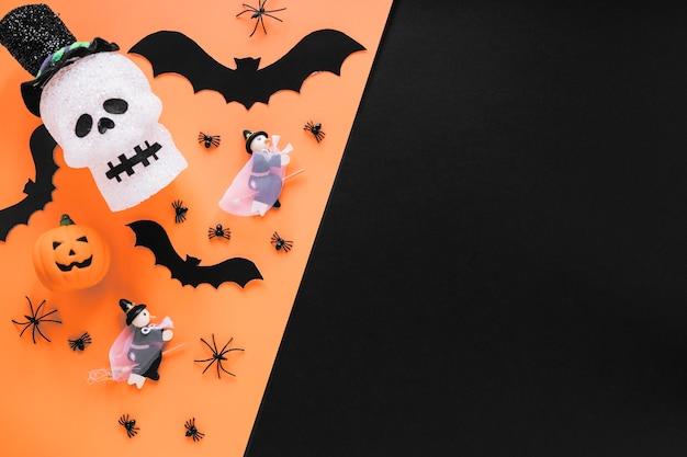 Caveira de desenho e morcegos com abóboras