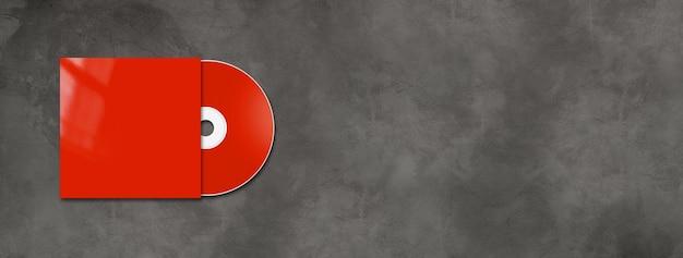 Cd vermelho - rótulo de dvd e modelo de capa isolado em banner horizontal de concreto