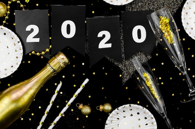 Celebração de ano novo 2020 champanhe e glitter