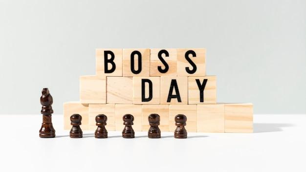 Celebração do dia do chefe com peças de xadrez