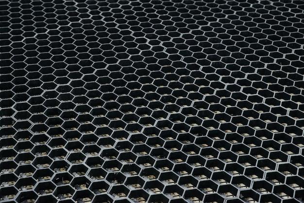 Célula de borracha de forma geométrica padrão fundo de grade de textura