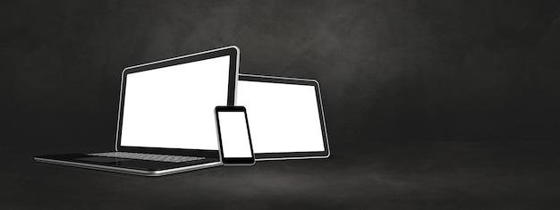 Celular laptop e tablet pc digital em concreto escuro