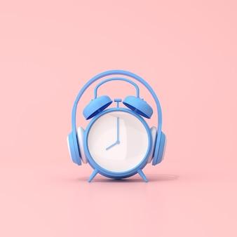 Cena conceitual de despertador azul com fone de ouvido, renderização em 3d.
