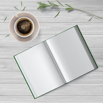 Cena simples vista superior com café e um livro em branco