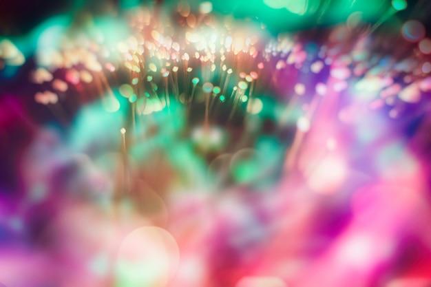 Cenário brilhante de férias. fundo festivo de natal. fundo abstrato elegante com bokeh luzes desfocadas e estrelas
