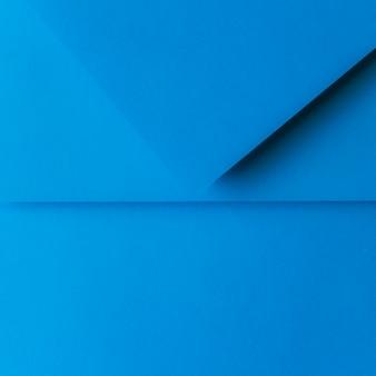Cenário de papel dobrado azul