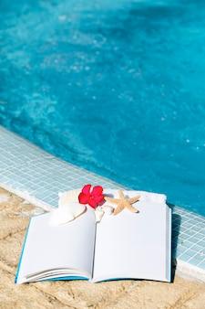 Cenário de spa com flor e livro branco