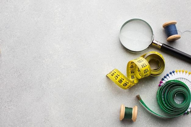 Centímetro para costura e lupa