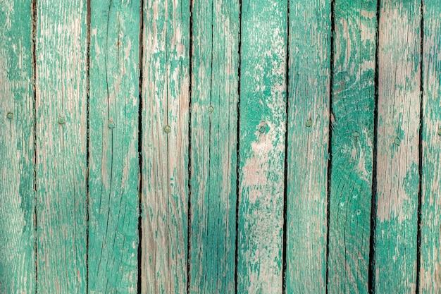 Cerca de madeira verde velha. tábuas pintadas. textura de madeira vintage.