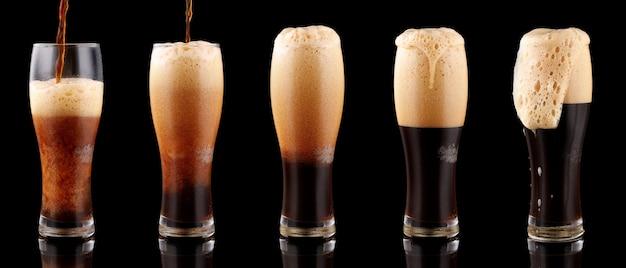 Cerveja escura não filtrada com espuma em copo