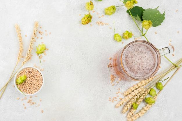 Cerveja plana e sementes de trigo