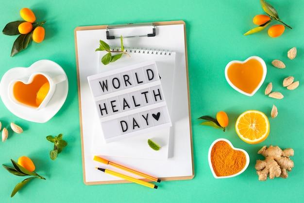 Chá com limão e mel, potenciadores de imunidade e remédios para resfriado, vista de cima. dia mundial da saúde.