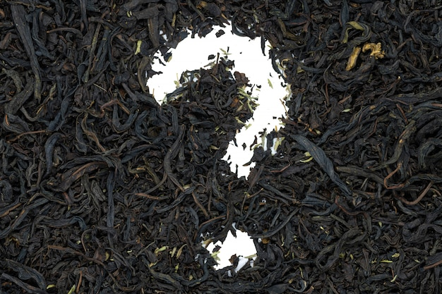 Chá do fireweed com erva do tomilho, forma do ponto de interrogação, fim acima, isolado.