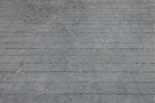 Chão de tijolo preto superfície closeup no caminho textura de fundo