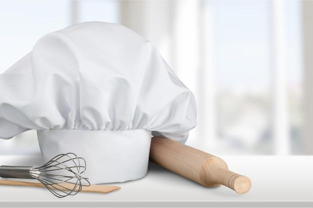 Chapéu de chef e utensílios de cozinha