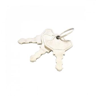 Chave de casa closeup, chave de metal isolada no branco