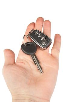 Chave do carro com alarme isolado na mão