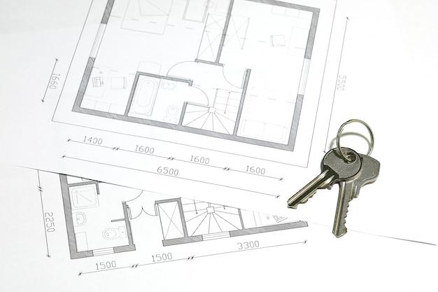 Chaves de casas em close-up de plantas baixas de residências