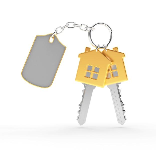 Chaves douradas em formato de casa com chaveiro em branco