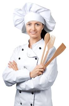 Chef feminina com um chapéu e um casaco tradicionais