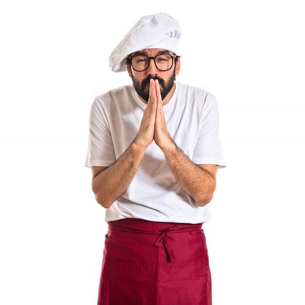 Chef suplicando sobre fundo branco