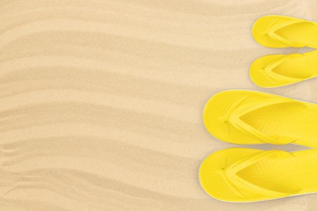 Chinelos amarelos para adultos e crianças na vista de cima da praia