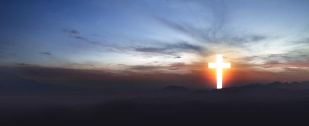 Christian cross no campo com um fundo do céu ao nascer do sol