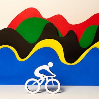 Ciclista de papel com ondas coloridas abstratas